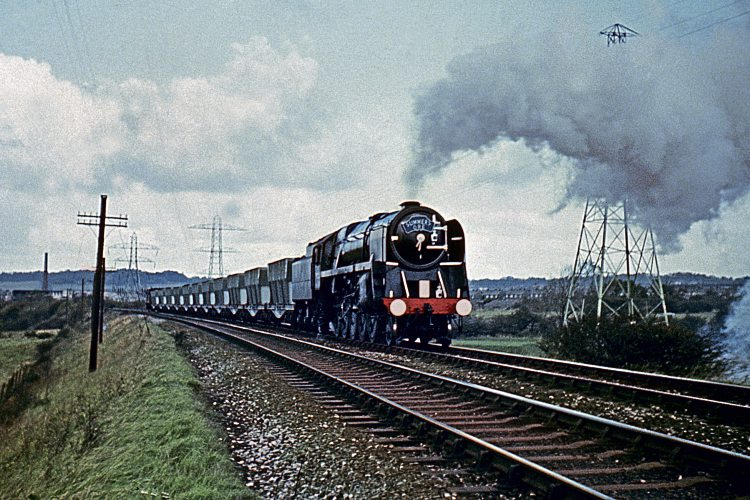 Wirral steam finale; BR Standard 9F 2-10-0 No. 92203 (now preserved) heads past Prenton golf course with the last steam-hauled iron ore train from Bidston dock to John Summers' steelworks at Shotton on November 6, 1967. COLOUR-RAIL.COM 381167