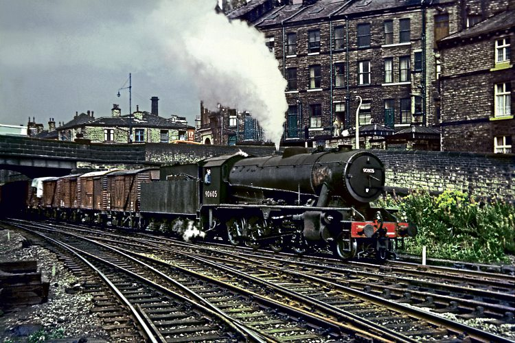 Royston-based WD Austerity 2-8-0 No. 90605, one of the last locomotives to be overhauled at Cowlairs, heads an eastbound freight into Shipley on August 31, 1966.  DAVE RODGERS