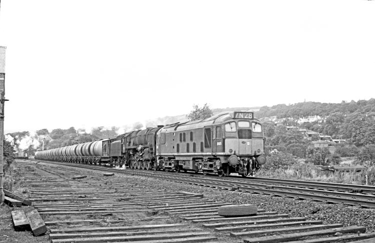 BR Sulzer Type 2 diesel D5075 and BR Standard 9F 2-10-0 No.  92118 approach Bingley with the Heysham-Neville Hill oil train on September 30, 1967. This combination of motive power continued to work this train after the end of steam in the West Riding. JOHN MARSH