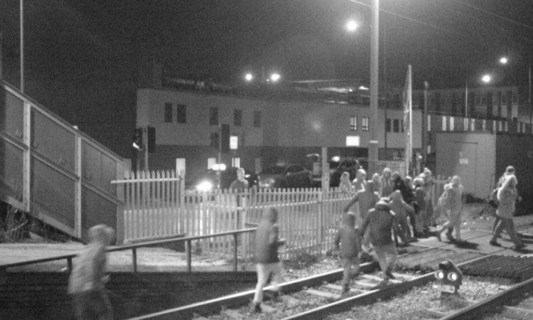 People-on-the-tracks-at-Grays-level-crossing-in-Essex